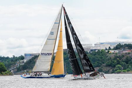 STOCKHOLM - JUNE, 30: Sailboat HUGO BOSS in a faceoff with sailboat HYUNDAI in the depart from Stockholm in the ÅF Offshore Race (Gotland runt), June 30, 2013 in Stockholm, Sweden