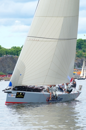 STOCKHOLM - JUNE, 30  Sailboat DataCom with crew close to shore departing from Stockholm in the �F Offshore Race  Gotland runt  class ORC A, June 30, 2013 in Stockholm, Sweden
