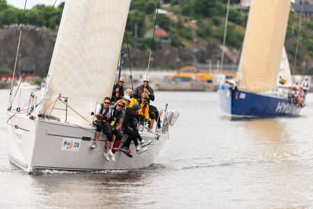 STOCKHOLM - JUNE, 30  Sailboat 4TYONE close to shore with crew and sailboat Hyundai in background departs from Stockholm in the �F Offshore Race  Gotland runt  class ORC A, June 30, 2013 in Stockholm, Sweden