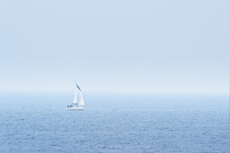 Sailboat in sea during a misty day photo