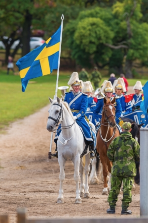 STOCKHOLM - SEP, 22  The mounted music corps waiting for entering the stadium at the The Mounted Guard event for the public in Ryttarstadion Sep 22, 2013 in Stockholm, Sweden