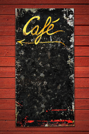 Old coffee sign in weathered metall on a red vintage wall, space for own text photo