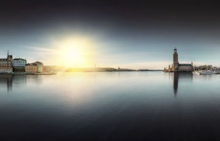Stockholm City Hall with Riddarholmen to the right during dawn