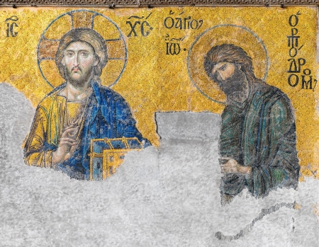 A Byzantine mosaic in the old church Hagia Sophia showing the Judgment day with Jesus Christ to the left and John the Baptist to the right, from the 12th century, Istanbul, Turkey