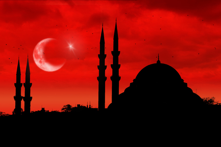 Mosque silhouette during red sunset with Turkish flag, moon and star Stock Photo