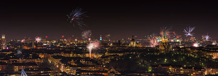 Fireworks over Stockholm with the City hall in center during New years eve, panorama photo