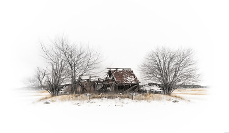 Abandoned barn on a hill during winter photo