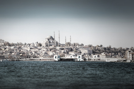 Galata bridge from the sea in Istanbul in desaturated style, Turkey
