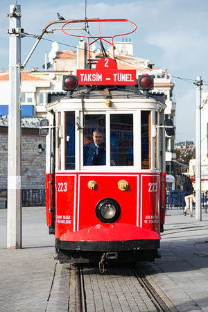 ISTANBUL - NOV, 21  A red classic tram with driver at the Taksim square in the Beyoglu district of Istanbul, Nov 21, in Istanbul, Turkey 2013
