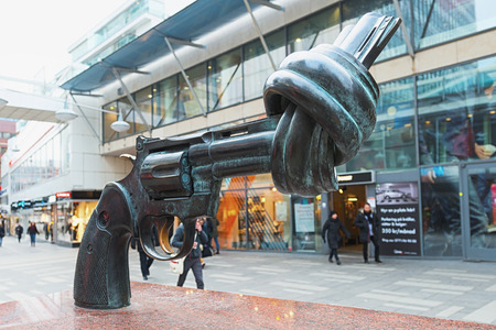 non violence: STOCKHOLM, FEBRUARY 04  The bronze sculpture, Non violence of the artist Carl Fredrik Reutersward at Sergelgatan, on February 04, 2014, Stockholm, Sweden  There are currently 16 sculptures all around the world with this Colt Python Magnum revolver with kn