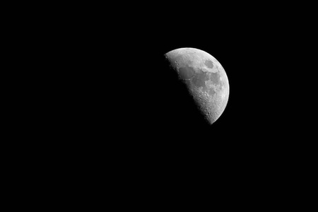 Half Moon Phase or the first quarter phase on black Stock Photo