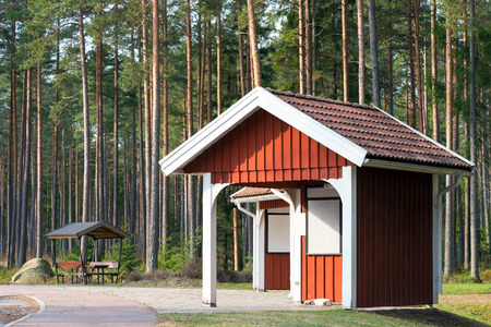 Roadside rest area in the forest besides the highway during spring, Sweden photo