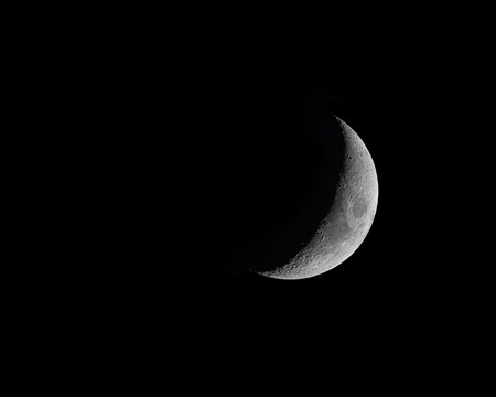 Waxing Crecent Moon Phase isolated on black photo