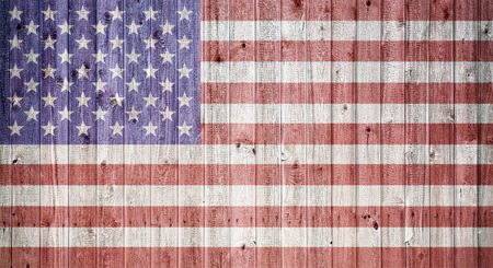 faded: American flag on a wheatered wooden background, Composite in vintage look