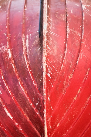 keel: Small boat upside down with red used keel with scratches and rips
