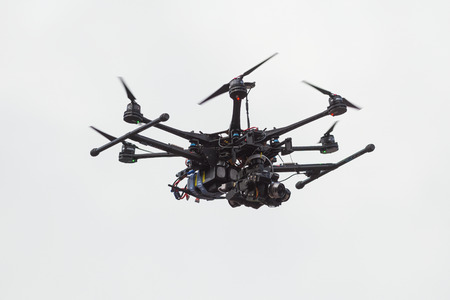 STOCKHOLM - MAY 31: Camera drone hovering above the runners at ASICS Stockholm Marathon 2014. May 31, 2014 in Stockholm, Sweden.