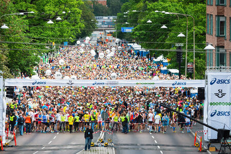 STOCKHOLM - MAY 31: The first group of two waiting for the start in ASICS Stockholm Marathon 2014. May 31, 2014 in Stockholm, Sweden. 16736 people started 2014.