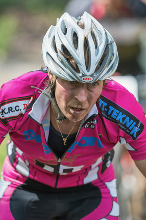 mountainbike: TULLINGE, STOCKHOLM - JUNE 8: Closeup of a mountain bikers face in the Lida loop mountainbike race 2014 during a sunny day in the Swedish nature. June 8, 2014 in Stockholm, Sweden. One of the biggest MTB races in sweden. Editorial