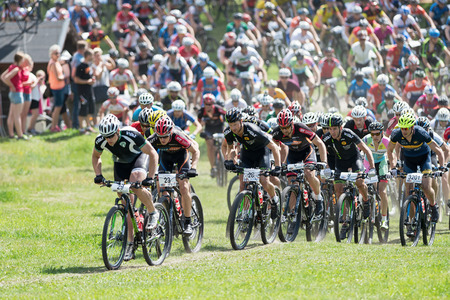 mountainbike: TULLINGE, STOCKHOLM - JUNE 8: After the start of the Lidaloop mountainbike race 2014 with a leader group. June 8, 2014 in Stockholm, Sweden. One of the biggest MTB races in sweden. Editorial