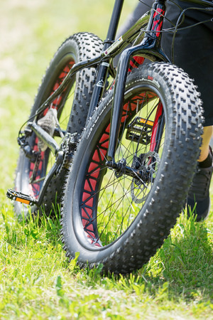 TULLINGE, STOCKHOLM - JUNE 8: Rider in public with a bike with massive tires at the Lidaloop race 2014 during a sunny day in the Swedish nature. June 8, 2014 in Stockholm, Sweden.
