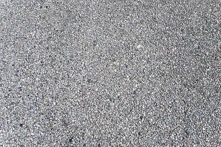 Natural asphalt texture with gravel, detailed closeup, rustic background  photo