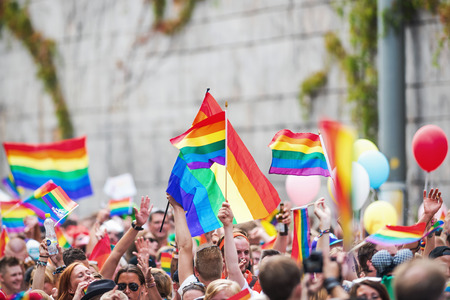 transsexual: STOCKHOLM - AUG 2: Happy crowd waving rainbow flags during Stockholm Pride Parade at Hornsgatan. August 2, 2014 in Stockholm, Sweden. Editorial