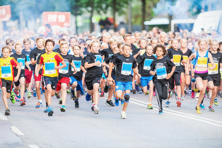STOCKHOLM - AUG, 16: Closeup after the chaotic start when the young kids runs in the Midnight Run for children (Lilla Midnattsloppet) event. Aug 16, 2014 in Stockholm, Sweden