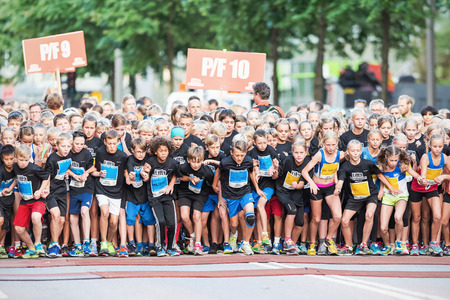 STOCKHOLM - AUG, 16: Excited and nervous kids just after the start in the Midnight Run for children (Lilla Midnattsloppet) event. Aug 16, 2014 in Stockholm, Sweden