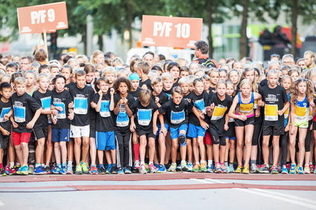 STOCKHOLM - AUG, 16: Excited and nervous kids waiting for the start in the Midnight Run for children (Lilla Midnattsloppet) event. Aug 16, 2014 in Stockholm, Sweden