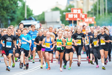 STOCKHOLM - AUG, 16: Start of one of many groups for children in the Midnight Run for children (Lilla Midnattsloppet) event. Aug 16, 2014 in Stockholm, Sweden