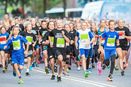 lilla: STOCKHOLM - AUG, 16: The leading group just after the start in the Midnight Run for children (Lilla Midnattsloppet) event. Aug 16, 2014 in Stockholm, Sweden Editorial