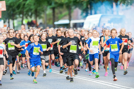 STOCKHOLM - AUG, 16: The leading group just after the start in the Midnight Run for children (Lilla Midnattsloppet) event. Aug 16, 2014 in Stockholm, Sweden