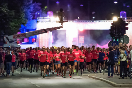 STOCKHOLM - AUG, 16: Just after start of one of many groups in the Midnight Run (Midnattsloppet) event. Aug 16, 2014 in Stockholm, Sweden