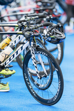 STOCKHOLM - AUG, 23: Front wheels of triathlon bikes with all other equipment at the transition zone in the Mens ITU World Triathlon Series event Aug 23, 2014 in Stockholm, Sweden