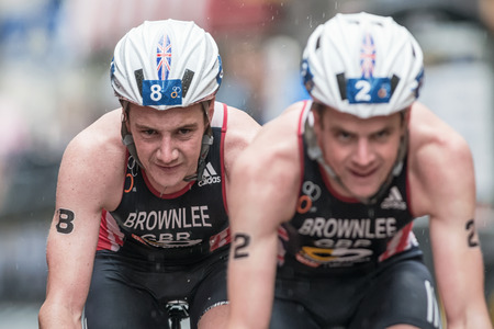 STOCKHOLM - AUG, 23: Closeup of Alistair Brownlee with his brother Jonathan on the wet cobblestone road at the Mens ITU World Triathlon Series event August 23, 2014 in Stockholm, Sweden