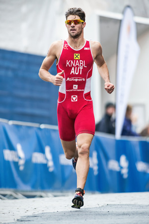 STOCKHOLM - AUG, 23: Alois Knabl from Austria running in the old town in the Mens ITU World Triathlon Series event August 23, 2014 in Stockholm, Sweden.
