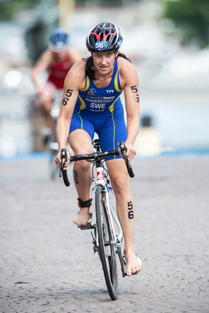 STOCKHOLM - AUG, 23: Asa Annerstedt from Sweden after the transition to cycling at the Womans ITU World Triathlon Series event August 23, 2014 in Stockholm, Sweden