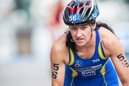 STOCKHOLM - AUG, 23: Asa Annerstedt from Sweden in closeup after the transition to cycling at the Womans ITU World Triathlon Series event August 23, 2014 in Stockholm, Sweden