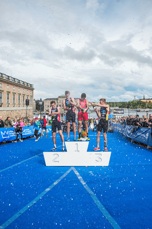 gomez: STOCKHOLM - AUG, 23: Celebrations with the overall leader Javier Gomez in the Mens ITU World Triathlon Series event August 23, 2014 in Stockholm, Sweden. Alistair Brownlee got the second place.