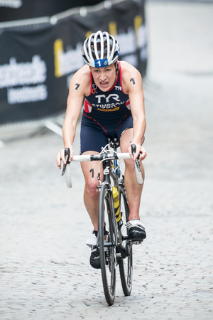 STOCKHOLM - AUG, 23: Jodie Stimpson from Great Britain after the transition to cycling at the Womans ITU World Triathlon Series event August 23, 2014 in Stockholm, Sweden