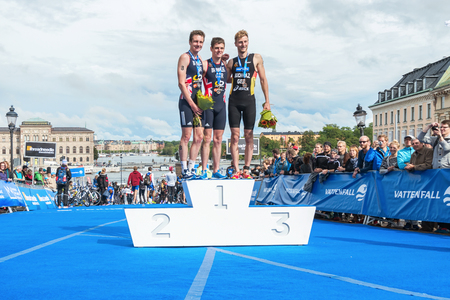 STOCKHOLM - AUG, 23: The three podium winners in the Mens ITU World Triathlon Series event August 23, 2014 in Stockholm, Sweden. Alistair Brownlee got the second place. Brownlee, Brownlee and Buchholz Editorial