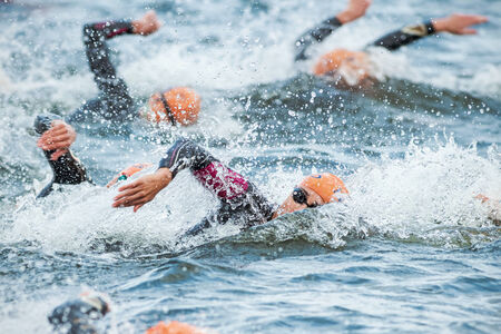 STOCKHOLM - AUG, 23: Triathletes swimming in the cold water at the Womans ITU World Triathlon Series event August 23, 2014 in Stockholm, Sweden