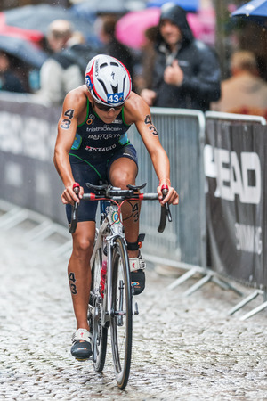 STOCKHOLM - AUG, 23: Luisa Baptista from Brasil cycling in the rain at the Womans ITU World Triathlon Series event August 23, 2014 in Stockholm, Sweden