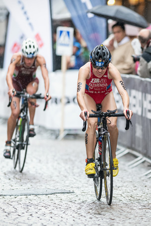 STOCKHOLM - AUG, 23: Alexandra Razarenova from Russia cycling in the rain at the Womans ITU World Triathlon Series event August 23, 2014 in Stockholm, Sweden