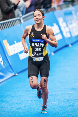 anja: STOCKHOLM - AUG, 23: Anja Knapp from Germany running to the finish line in the Womens ITU World Triathlon Series event 23, 2014 in Stockholm, Sweden Editorial