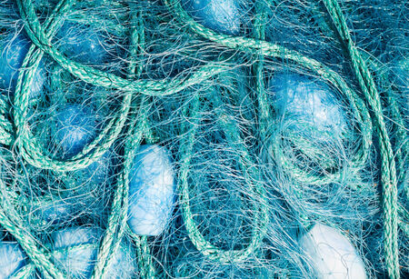 floaters: Close view of some blue fishing net floaters on the docks.