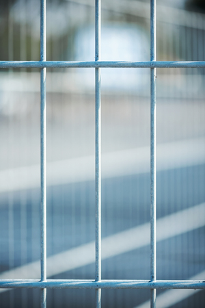 Closeup of a metal fence with blurred background photo