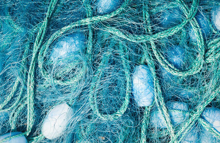 floaters: Close view of some blue fishing net floaters on the docks Stock Photo