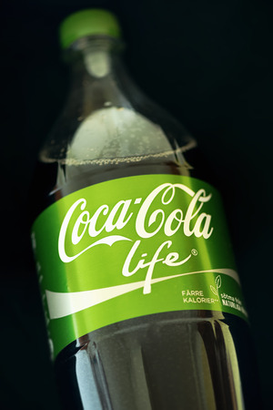 Stockholm, Sweden - Sep 23, 2014: Coca Cola Pet bottle in the new green Life edition with lower amount of calories. Coca Cola is one of the worlds bestselling soft drink ever.