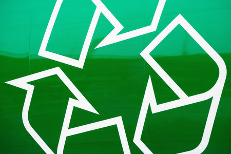 Recycling logo on green background at the side of an garbage truck, Sweden photo